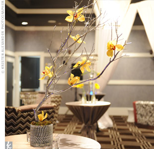 A silver-painted branch adorned with yellow flowers added simple sophistication to the decor.