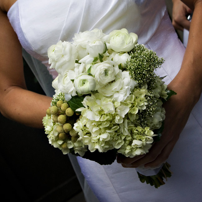 Heather originally wanted an all-anemone bouquet, but the flowers were out of season. Instead, she carried ranunculus, berries, hydrangeas and heather, which brings good luck to brides, according to Scottish tradition.