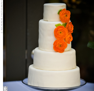 Orange sugar ranunculus topped the modern cake. The baker gave the dessert dramatic height by doubling the width of the third tier. Heather also served her guests a traditional Scottish wedding fruitcake she made herself.