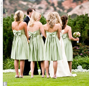 The sash and large bow on the bridesmaids' dresses mimicked the one on Kelly's gown and give the bridal party a cohesive look. The bridesmaids each expressed their individual style by choosing their own jewelry.