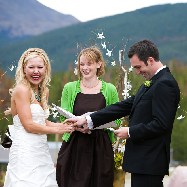 Amber and Josh share a passion for snowboarding, so they chose their favorite ski resort for the ceremony. They exchanged vows outside a private lodge surrounded by mountains, trees and ski runs.