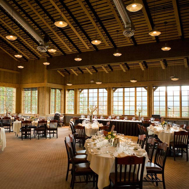 The beauty of the lodge made decorating easy. Three pillar candles lined every window in the room and the tables were topped with clean white linens. A sprig of rosemary decorated each napkin.