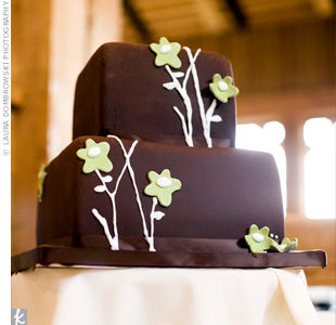 Amber and Josh loved their invitation so much they modeled their cake after it. They chose a simple, square design with chocolate icing and green floral accents.