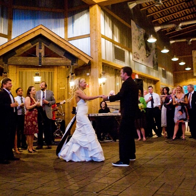 "A popular local band, Kick'd, played Jack Johnson's ""Better Together"" for the couple's first dance. Amber and Josh chose the group because they could play a variety of music that would appeal to all of their guests."