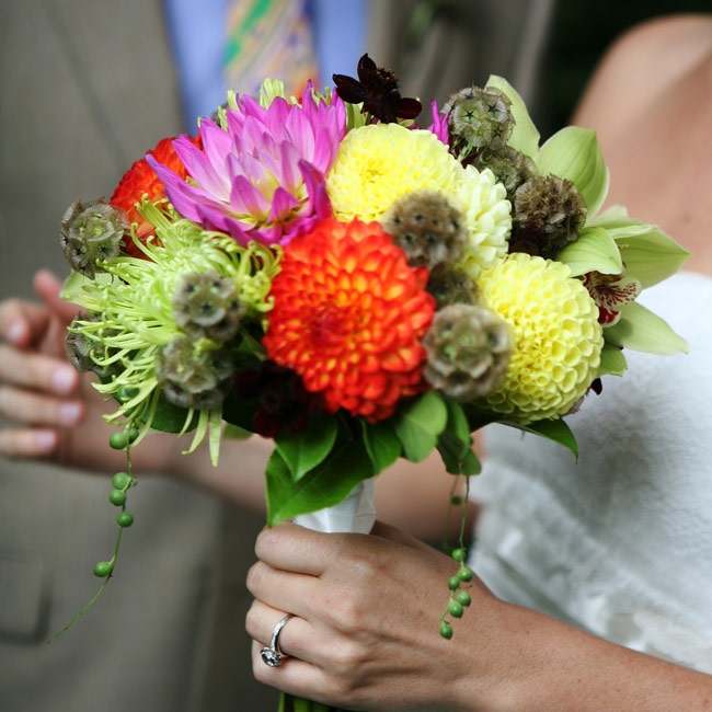 Darcie's bouquet reflected the fun and cheery style of her décor. Her florist bundled vibrant blooms, like dahlias and spider mums, then wrapped the stems in a satin ribbon.