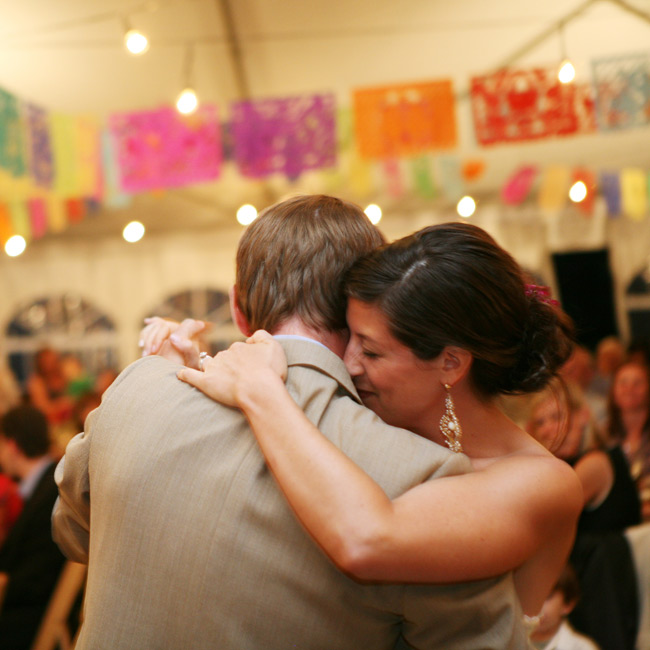 "The couple grooved to their band's rendition of John Prime's ""Glory of True Love"" for their first dance."