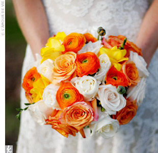 Kit chose sunny bursts of orange ranunculus and bright yellow freesia to offset the soft garden roses in her bouquet and her ivory Monique Lhuillier lace gown.
