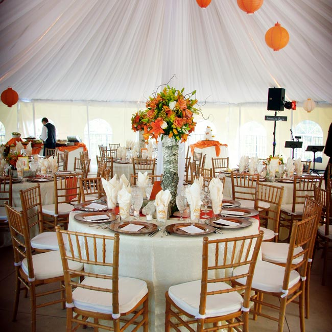 To add a little more color to the reception tent, Kit and Charlie hung bright Chinese paper lanterns.