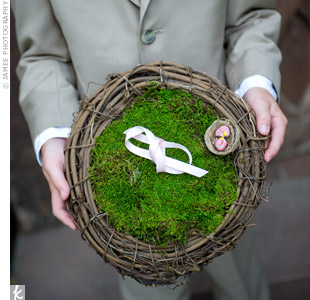 Instead of a pillow, Susan's nephew carried the rings in a bird's nest made by the bride's mother. Two miniature birds were attached to a bed of moss with the rings tucked neatly inside and tied with a ribbon.