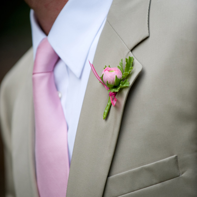 To match Susan's maids, Nathan's groomsmen donned pink ranunculus buds and fresh herbs on their lapels.