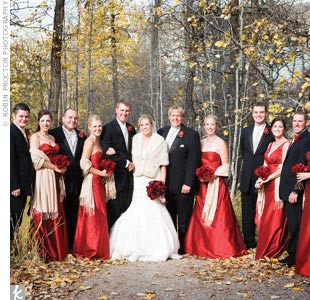 Suzanne wanted her maids to be comfortable and unique, but still wanted a cohesive look. The ladies kept the style consistent by wearing full-length, scarlet, silk shantung gowns in a variety of styles. Michael's groomsmen incorporated the wedding colors into their Kenneth Cole tuxes by wearing gold vests and ties.