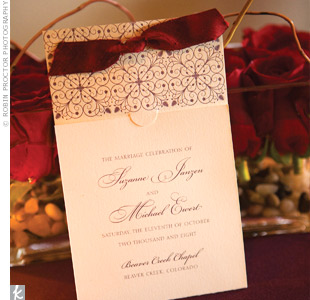 The stationery designer blended the wrought iron and pinecone details into an elegant motif for the invitations and programs. The programs were tied with a scarlet silk-dupioni ribbon.