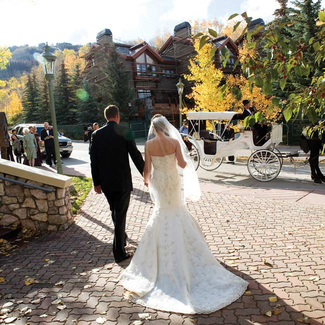 While guests headed for the reception, Suzanne and Michael took a romantic horse-drawn carriage ride around the resort–the perfect opportunity to take some private photographs.