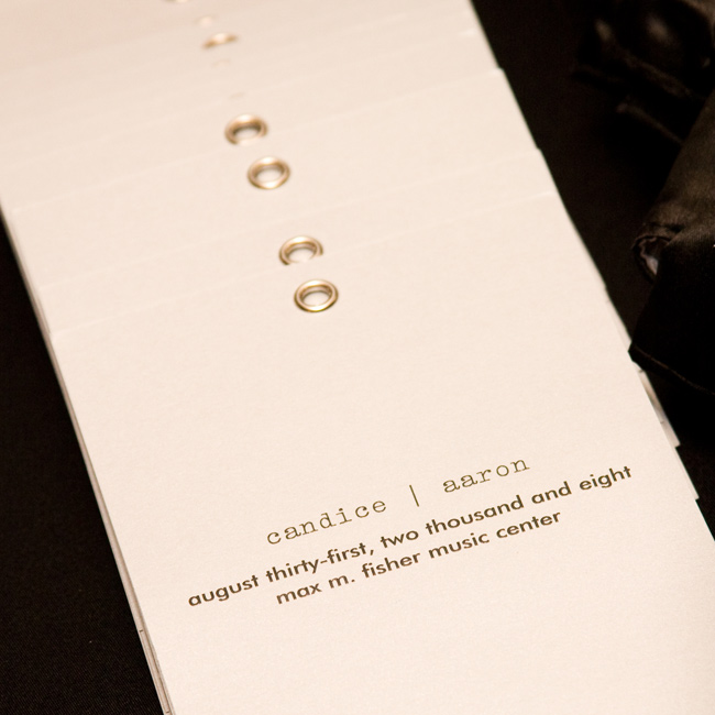 White paper booklets printed with black typewriter print detailed the couple's wedding party and ceremony. The lowercase font contributed to the programs' modern, minimalist look.