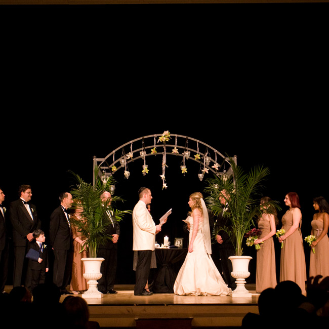 Candice and Aaron exchanged vows in a traditional Jewish ceremony beneath a huppah on-stage at the Detroit Symphony Orchestra Hall.