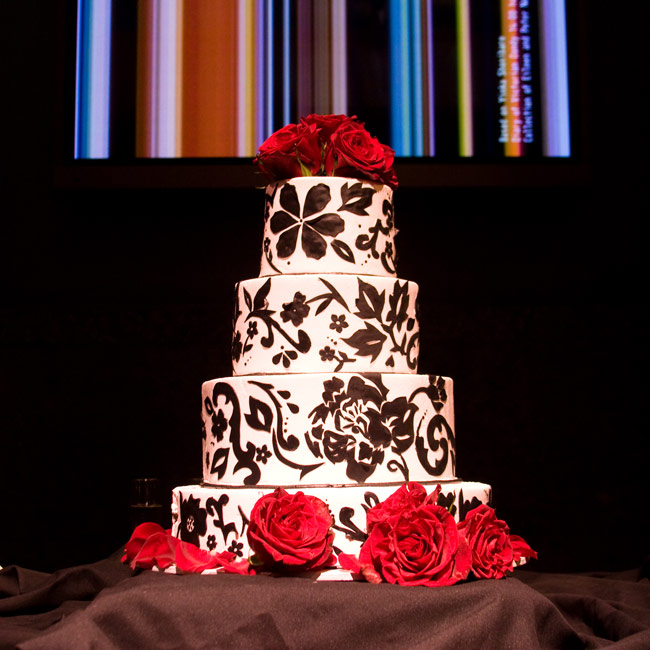 Candice and Aaron went for an art-deco look with their four-tiered chocolate cake. Swirling black fondant, and fresh flowers embellished the dessert.