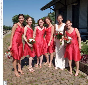 Elisabeth's mom also made the bridesmaids tea-length silk shantung dresses. Freshwater pearl necklaces added elegance to the flirty dresses (that the girls could really wear again!).