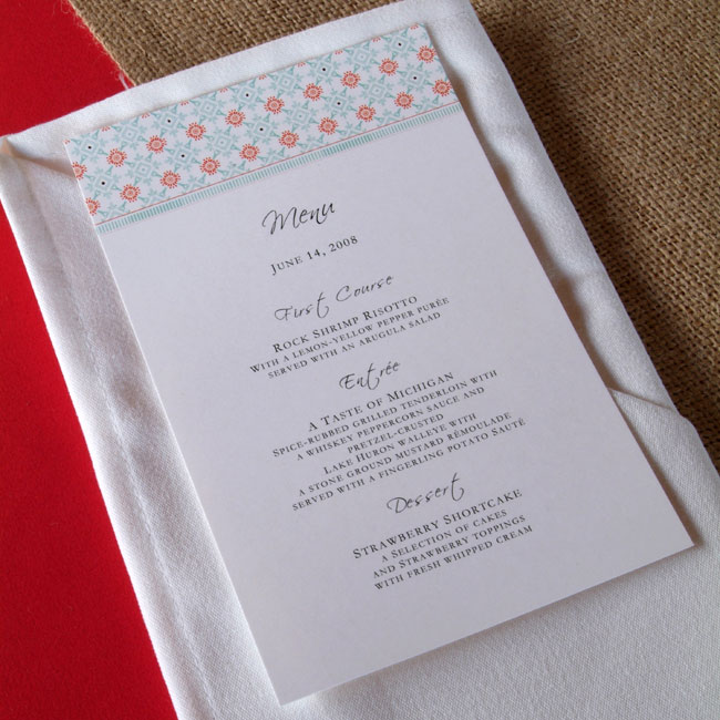 The couple spruced up white napkins with their monogram stamp, a brilliant idea for personalizing plain linens (don't do this on rented ones!). The menu cards were the finishing touch to the place settings.