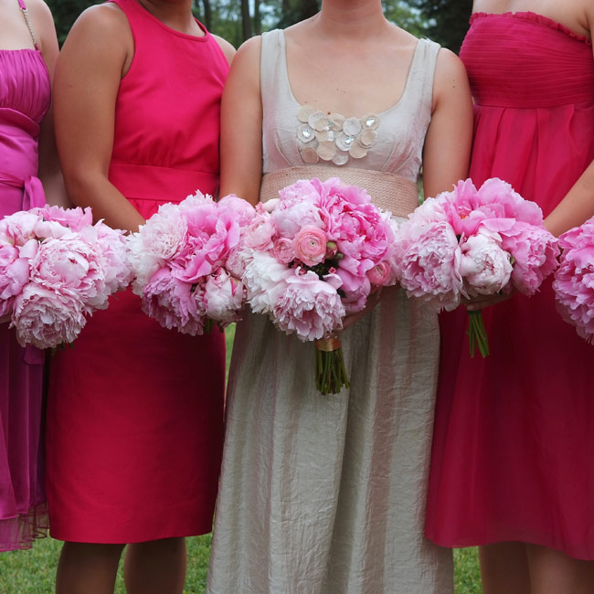 Melissa carried a hand-tied bouquet of peonies and ranunculus in various shades of pink for extra texture.