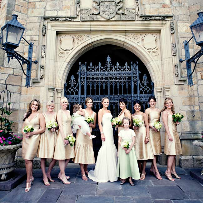 Green and white bouquets popped against the bridesmaids' champagne, silk gowns (that they chose themselves).
