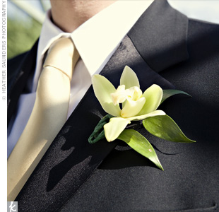 A single green orchid decorated Michael's lapel.
