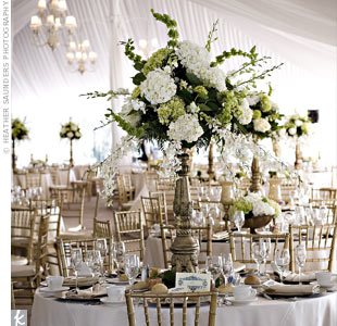 Gold, antique-style vases held white orchids mixed with green and white hydrangeas.