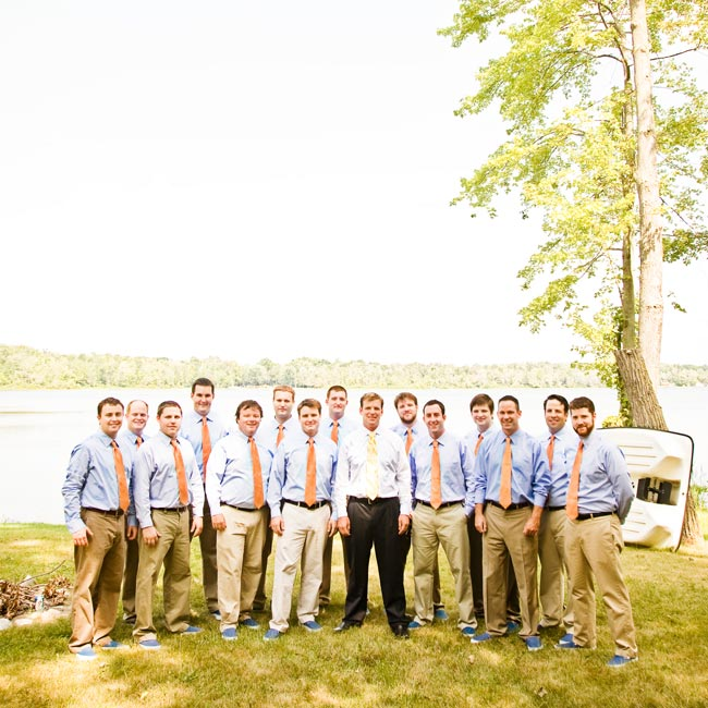 Keeping with the casual tone, the groomsmen wore khaki pants with light blue shirts. For their attendant gifts, the couple gave them these orange ties and navy blue Vans sneakers. The groom sported a more formal look with black pants and dress shoes.