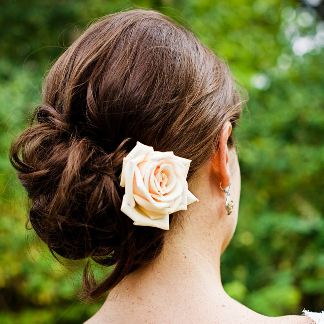 A freshly-picked cream rose dressed up Katie's simple up-do.