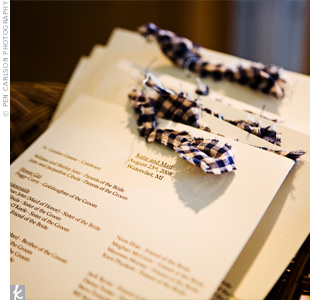 Making the programs was a family affair! The bride's sisters and mom cut the papers and tied them together with gingham-print ribbon, a pattern that's as country as it gets.
