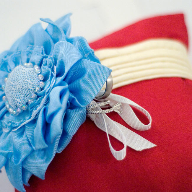 Erich's son, Evin, served as the (little) best man, but he carried the ring pillow anyway.  Margaret's mom made the pillow and her aunt created the blue silk flower to incorporate both wedding colors.
