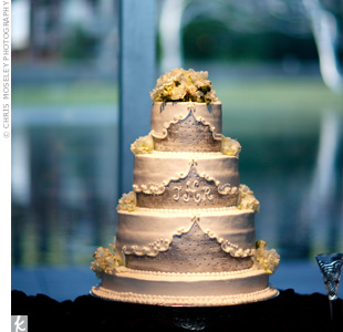 The three-tiered cake incorporated details from Jill's dress, while fresh hydrangeas topped it off. The couple's monogram appeared on the middle layer -- a subtle detail that tied together several ceremony and reception details.