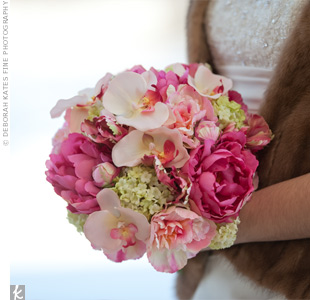 Lindsey carried all of her favorite flowers in her bouquet -- peonies, ruffled tulips, and orchids -- in white and shades of pink.