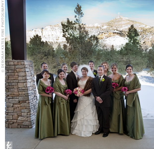 Lindsey's bridesmaids wore olive green, taffeta gowns with matching shawls. Cody's groomsmen dressed in brown tuxedos that were accented with green button mum and orchid boutonnieres.