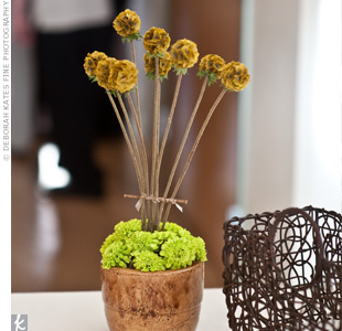 Lindsey found the idea for her centerpieces in a home decorating magazine and was thrilled when her florist was able to duplicate the design.