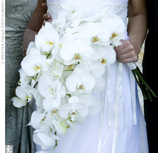 Georgina carried phalaenopsis orchids adorned with a jeweled three-leaf clover pendant, which she also added to her bridesmaids&#39; bouquets.