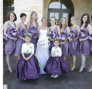 The nine bridesmaids each wore the same purple V-neck silk gowns by Vera Wang. As a gift, Georgina gave each maid a different pair of earrings.