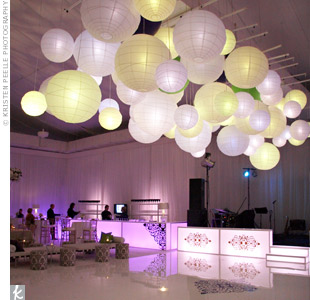 Fifty paper lanterns in assorted sizes hung above the dance floor. The soft shades of green and purple perfectly incorporated the couples wedding colors without overwhelming the mostly-white d&#233;cor.