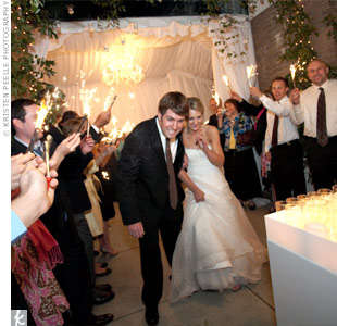 Guests held sparklers as the newlyweds made their escape to a waiting limousine.