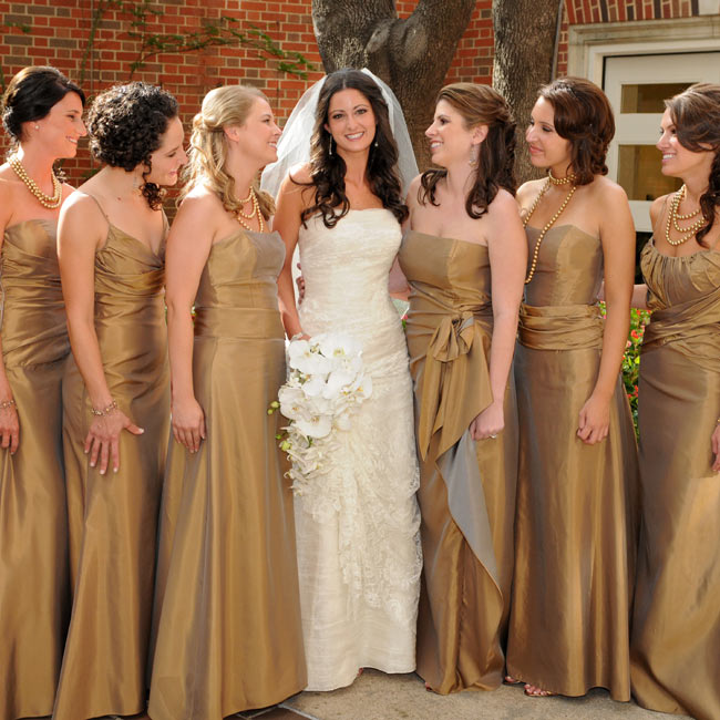 Each of the seven bridesmaids chose her own long, toffee-colored gown by Jim Hjelm -- a perfect way to let your maids feel and look good on your big day while still having a unified look.