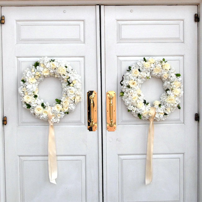 The couple got married in the same church Kate's parents exchanged vows 32 years earlier. Wreaths of roses and hydrangeas adorned with a matching peach ribbon hung from the church doors.
