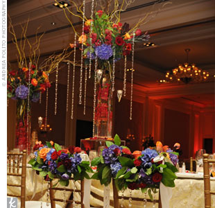 Lighting that washed the walls in colors that changed throughout the reception transformed the formal ballroom at the Ritz-Carlton in Dallas into a bright, glowing space.