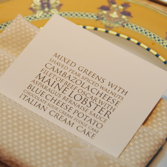 Square, gold menus with a modern font awaited guests at their place settings.
