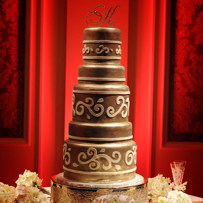 "A crystal ""K"" topped the multi-layered, Italian cream cake decorated with an ivory Florentine design."