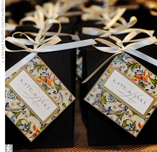 Guest took home cheese pastries from Kate's favorite Dallas bakery packaged in bronze boxes, tied with ivory ribbon and decorated with a tag matching the save-the-dates and escort cards.