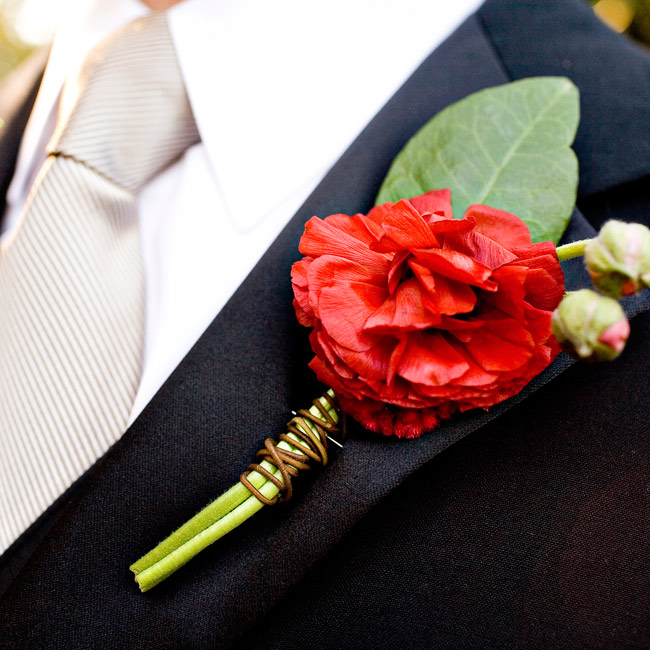 Jeff's red boutonniere popped against his tux, adding bold detail to his classic style.