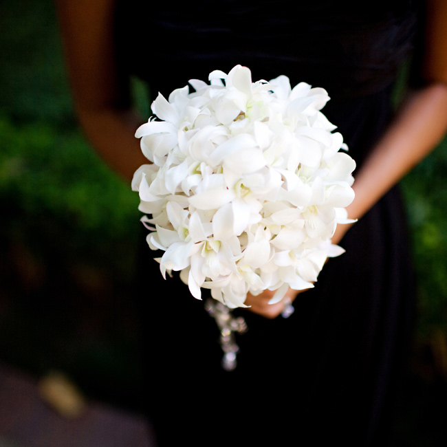 As part of their gifts for being in her wedding, Stephanie gave each bridesmaid a different cross, which she incorporated into the bouquet wraps.