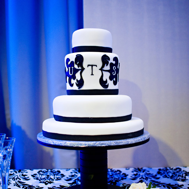 Black ribbon and an edible version of the couple's monogram decorated the four-tiered, fondant cake.
