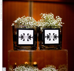 Stephanie filled 200 cubed vases with baby&#39;s breath and tied them in black ribbon for guests to take home. The only problem? Their large size made guests think they were decorations instead of thank-you gifts, so the couple had 100 left over the next day.