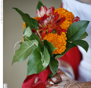 Laurie's bouquet included marigolds and bright red dahlias and complemented the couple's traditional Indian color palette. The bride's friend, a garden designer, created all the floral arrangements using local greenery and flowers.