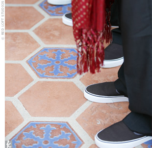 The groomsmen wore traditional scarves and kurta shirts. Anil, his groomsmen, and even the ring bearer personalized their looks with dark brown Vans sneakers, which were a gift from the couple.
